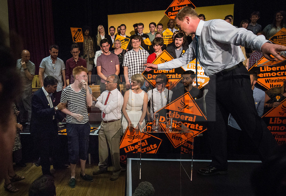 © Licensed to London News Pictures. 16/07/2015. London, UK. Tim Farron stops to check on the wellbeing of a Lib Dem supporter who collapsed whilst he was speaking at Islington Assembly Hall for his first rally as Leader of the Liberal Democrats, after beating Norman Lamb in the contest to succeed Nick Clegg. Photo credit : James Gourley/LNP