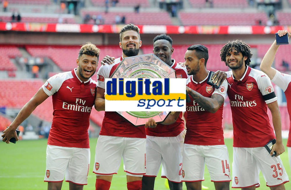 Football - 2017 Community Shield - Chelsea vs. Arsenal<br /> <br /> Arsenal players celebrate with the Shield at Wembley.<br /> l-r Alex Oxlade - Chamberlain, Olivier Giroud, Danny Welbeck, Theo Walcott and Mohamed Elneny<br /> <br /> COLORSPORT/ANDREW COWIE
