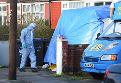 © Licensed to London News Pictures. 19/12/2018. London UK: Forensic officers at St Joseph's road in Enfield, north London after a male was found with fatal gun shot wounds at around 10 pm last night. Three men have been arested and are helping police with the murder investigation , Photo credit: Steve Poston/LNP