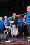Barbara Dundas opening the 2019 Guildford Songfest, on stage with Bernard Carney and the Spirit of the West Choir