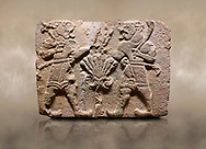 Aslantepe Hittite relief sculpted orthostat stone panel of Lion Men. Limestone, 1399-1301 BC. Anatolian Civilisations Museum, Ankara, Turkey.<br /> <br /> There are two lion-men with a sword at their waists on both sides of the tree of life. The figure on the right holds a sickle in his left hand resting on his shoulder and a symbol his right hand. The figure on the left carries a double-faced ax in his right hand. <br /> <br /> Against a brown art background.<br /> <br /> If you prefer to buy from our ALAMY STOCK LIBRARY page at https://www.alamy.com/portfolio/paul-williams-funkystock/hittite-art-antiquities.html . Type - Aslantepe - in LOWER SEARCH WITHIN GALLERY box. Refine search by adding background colour, place, museum etc.<br /> <br /> Visit our HITTITE PHOTO COLLECTIONS for more photos to download or buy as wall art prints https://funkystock.photoshelter.com/gallery-collection/The-Hittites-Art-Artefacts-Antiquities-Historic-Sites-Pictures-Images-of/C0000NUBSMhSc3Oo
