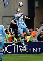Photo: Steve Bond/Richard Lane Photography.<br />Coventry City v Chelsea. FA Cup 6th Round. 07/03/2009. Leon Best (R) gets to the ball above Alex