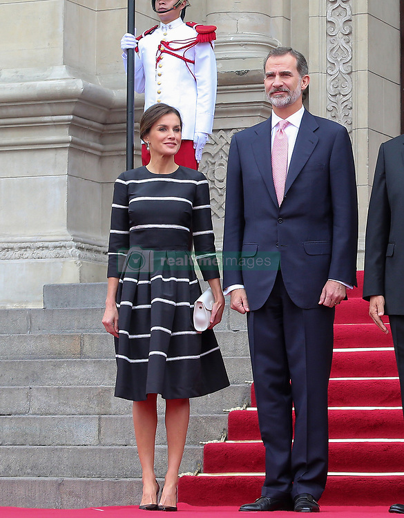 Letizia of Spain looks elegant in a striped dress as she and husband King Felipe touch down in Peru for three-day visit. Letizia, opted for a fit-and-flare dress as she and Felipe, arrived in Lima el 12 de noviembre de 2018 en Lima, Perú. The couple were greeted by Peru's President Martin Vizcarra and First Lady Maribel Diaz shortly after touching down in the capital. Letizia and Felipe are conducting a three-day tour of the country in a bid to strengthen ties between the two nations. 12 Nov 2018 Pictured: Letizia of Spain and King Felipe. Photo credit: FDA Media & Films / MEGA TheMegaAgency.com +1 888 505 6342