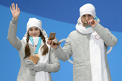 February 14, 2018 - Pyeongchang, South Korea - ANASTASIA BRYZGALOVA and ALEXSANDR KRUSHELNITEKII of Russia celebrate getting the bronze medal in the Mixed Doubles curling event in the PyeongChang Olympic games. (Credit Image: © Christopher Levy via ZUMA Wire)