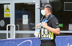 A policeman is seen outside the stadium wearing a face mask - Mandatory by-line: Arron Gent/JMP - 18/06/2020 - FOOTBALL - JobServe Community Stadium - Colchester, England - Colchester United v Exeter City - Sky Bet League Two Play-off 1st Leg