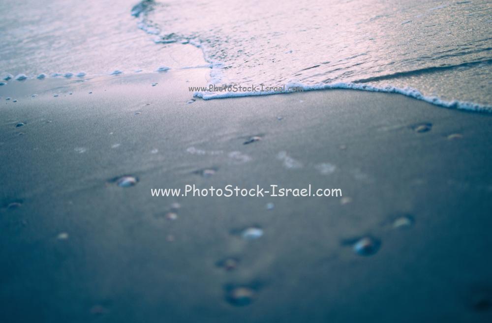 water ripples digitally manipulated beach close up