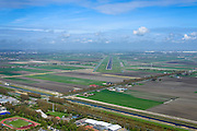 Nederland, Noord-Holland, Hoofddorp, 09-04-2014; zicht op de Polderbaan met in de voorgrond de randweg Weg om de Noord en Arnolduspark.<br /> Runway from Schiphol Airport, Polder runway.<br /> luchtfoto (toeslag op standard tarieven);<br /> aerial photo (additional fee required);<br /> copyright foto/photo Siebe Swart