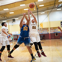 Patrica Chavira (22) of Rehoboth and Kaley Wyaco (50) battle for the rebound undertake rim during the championship game in Rehoboth on Saturday. Zuni won 48-37.