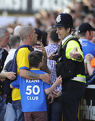 A police officer tries to reason with fans - Photo mandatory by-line: Joe Meredith/JMP - Mobile: 07966 386802 03/05/2014 - SPORT - FOOTBALL - Bristol - Memorial Stadium - Bristol Rovers v Mansfield - Sky Bet League Two
