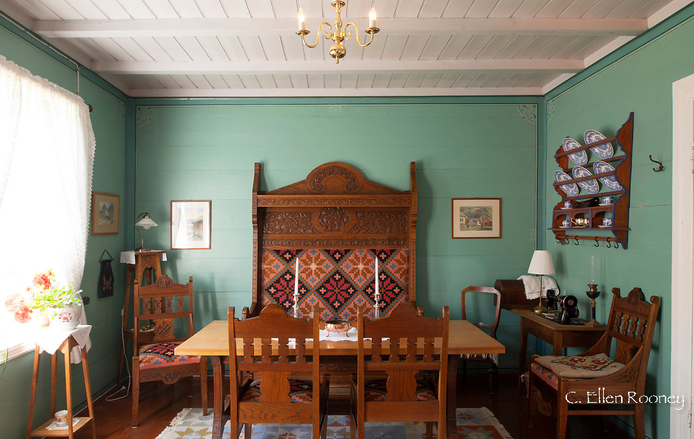 A colourfully painted dining room in a historic house in Agatunet, a heritage village in Aga on Sor Fjord, Vestlandet, Norway