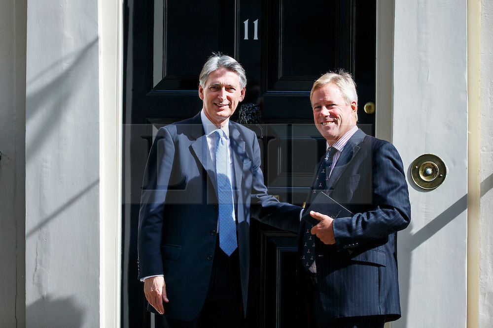 © Licensed to London News Pictures. 18/07/2016. London, UK. Chancellor of Exchequer PHILIP HAMMOND and Chairman of ARM Holdings, STUART CHAMBERS meet at No 11, Downing Street on Monday, 18 July 2016. The UK technology firm ARM Holdings is to be bought by Japan's Softbank for £24bn. Photo credit: Tolga Akmen/LNP