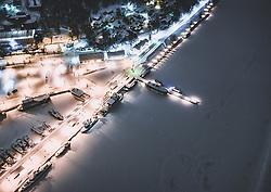 THEMENBILD - Blick auf die finnische Stadt Lahti mit den Lichtern der Stadt im Winter mit Schnee bedeckt, Boote ankern im Hafen umringt von einer Eisdecke, aufgenommen am 08. Februar 2019 in Lahti, Finnland // View of the Finnish city Lahti with the lights of the city in winter covered with snow, boats in the harbour, surrounded by a blanket of ice.. Lahti, Finland on 2019/02/08. EXPA Pictures © 2019, PhotoCredit: EXPA/ JFK