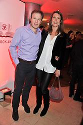 TOM BRADBY and his wife CLAUDIA BRADBY at the Costa Book Awards 2012 held at Quaglino's, 16 Bury Street, London SW1 on 29th January 2013.