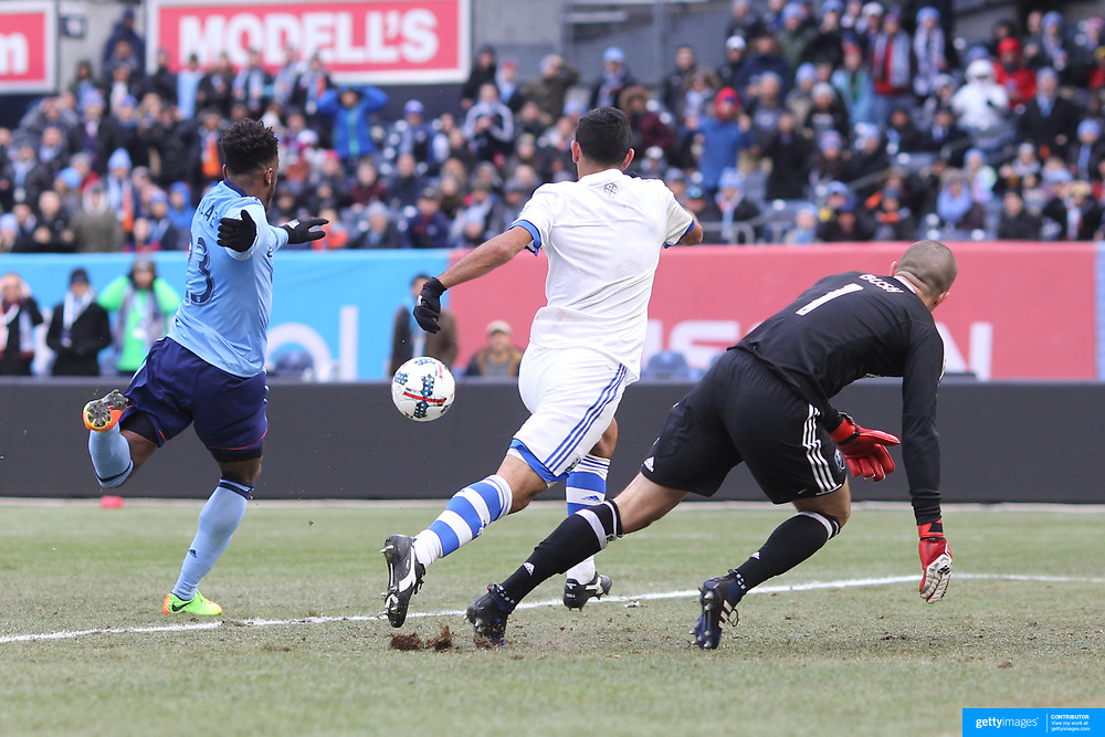 NEW YORK, NEW YORK - March 18: Rodney Wallace #23 of New York City FC moves in to score as Victor Cabrera #36 of Montreal Impact and goalkeeper Evan Bush #1 of Montreal Impact try and defend the shot during the New York City FC Vs Montreal Impact regular season MLS game at Yankee Stadium on March 18, 2017 in New York City. (Photo by Tim Clayton/Corbis via Getty Images)