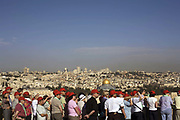 Tourists photograph the Old City as seen from the Mount of Olives, Jerusalem, Israel