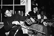 NEW ORLEANS, LA – OCTOBER 28, 2009: Musicians busk on the stoop of a coffee shop on Frecnhmen Street.
