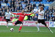 Cardiff city's Mats Daehli (l) looks to shoot past Fulham's Brede Hangeland. Barclays Premier league, Cardiff city v Fulham at the Cardiff city Stadium in Cardiff , South Wales on Sat 8th March 2014. pic by Andrew Orchard, Andrew Orchard sports photography