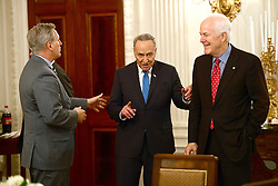 United States Senate Minority Leader Chuck Schumer (Democrat of New York), center, engages in conversation with US House Majority Leader Kevin McCarthy (Republican of California), left, as US Senate Majority Whip John Cornyn (Republican of Texas), right, looks on prior to the arrival of President Donald Trump at a reception for US House and US Senate Republican and Democratic leaders in the State Dining Room of the White House in Washington, DC, USA, on Monday, January 23, 2017. Photo by Ron Sachs/CNP/ABACAPRESS.COM