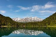 Ptarmigan Lake in Chugach National Forest on  the Kenai Peninsula of Southcentral Alaska. Spring. Morning.