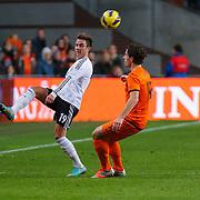 NLD/Amsterdam/20121114 - Vriendschappelijk duel Nederland - Duitsland, Mario Gotze in duel met Daryl Janmaat