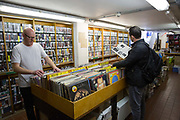 Two men searching for vinyl records at Music And Video Exchange in Greenwich on the 4th May 2018 in South London in the United Kingdom.