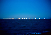 The Zeeland Bridge and Oosterschelde sea at late evening. The bridge is the longest bridge in the Netherlands with a length of 5km. It connects two Islands in Zeeland province. © Holland Kodak Ektar serie