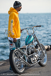 Loser Machine's Damin Lujan with his 1971 Triumph at the docks where it was picked up with all the invited builder's bikes before the Mooneyes show. Yokohama, Japan. Saturday December 2, 2017. Photography ©2017 Michael Lichter.
