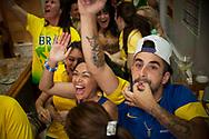 Brazilian football fans watch their national team's Russia 2018 World Cup Group E match against Costa Rica in a bar. Irun (Basque Country). June 22, 2018. (Gari Garaialde / BostokPhoto)