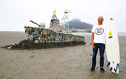 EDITORIAL USE ONLY<br /> Hugo Tagholm, CEO Surfers Against Sewage, unveils a 30ft model of a warship, which is made entirely of plastic marine litter is unveiled on Marazion Beach in Cornwall by campaign group Surfers Against Sewage, to highlight the growing threat of throwaway plastic in the seas and encourage the public to reduce their single-use plastic footprint.