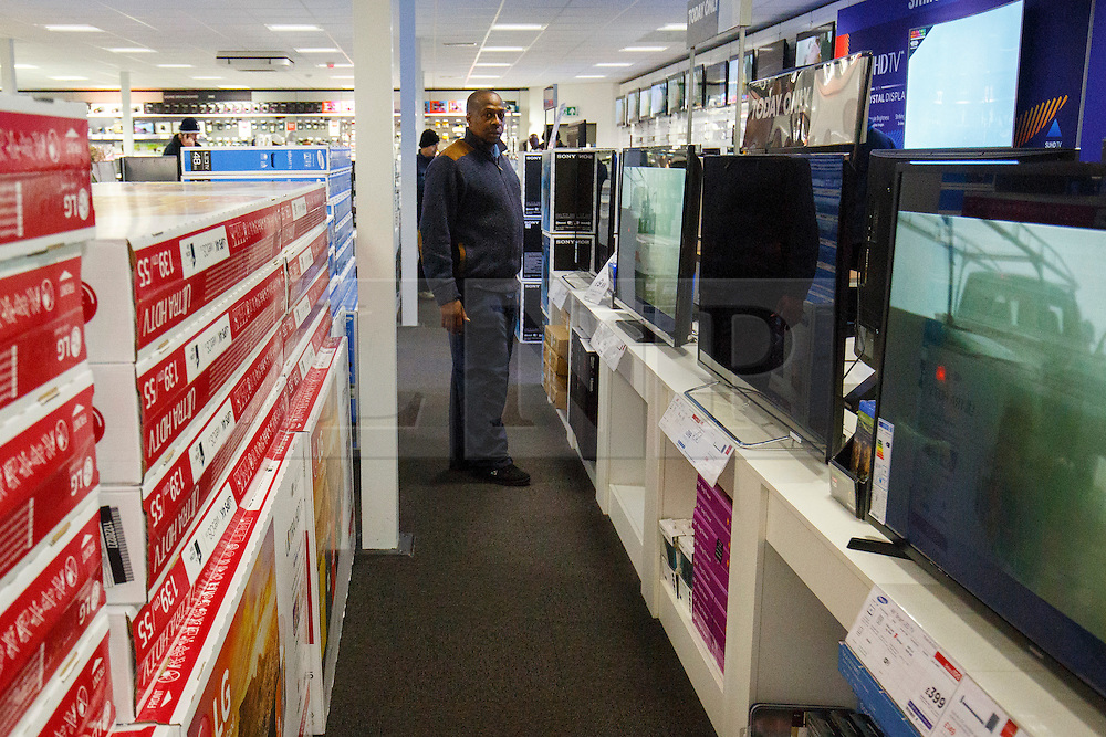 © Licensed to London News Pictures. 26/11/2015. London, UK. Black Friday shoppers buying reduced televisions at a Currys PC World store in Tottenham Hale, north London on Friday, 27 November 2015. Photo credit: Tolga Akmen/LNP
