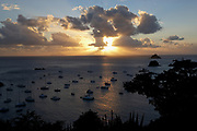 High view of the sunset over the boats in Gustavia port, St. Barthelemy, FWI