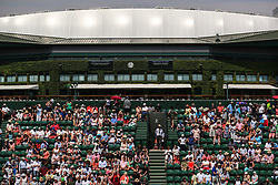 6 July 2017 -  Wimbledon Tennis (Day 4) - The roof of Centre Court can be seen behind the seats and spectators of Court 2 - Photo: Marc Atkins / Offside.