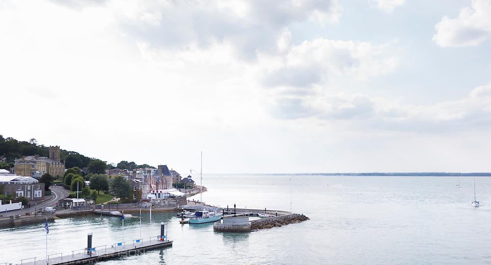 The Royal Yacht Squadron at the entrance to the Medina River in Cowes on the Isle of Wight. The famous club is 200 years old in 2015.<br /> The pontoon in the foreground is Trinity Landing.<br /> Picture date: Monday August 17, 2015.<br /> Photograph by Christopher Ison ©<br /> 07544044177<br /> chris@christopherison.com<br /> www.christopherison.com