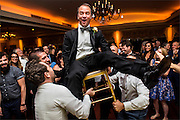 The groom with guests during a wedding reception held at Brooklake Country Club in Florham Park, New Jersey. A wedding at Brooklake Country Club in Florham Park, New Jersey.