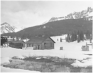 """Lizard Head RGS depot/section house and outbuildings in early spring.  No snow has been plowed this first year of abandonment.<br /> RGS  Lizard Head, CO  Taken by Chione, A. G. - ca. ? 4/1952<br /> In book """"RGS Story, The Vol. IV: Over the Bridges? Ophir Loop to Rico"""" page 283"""