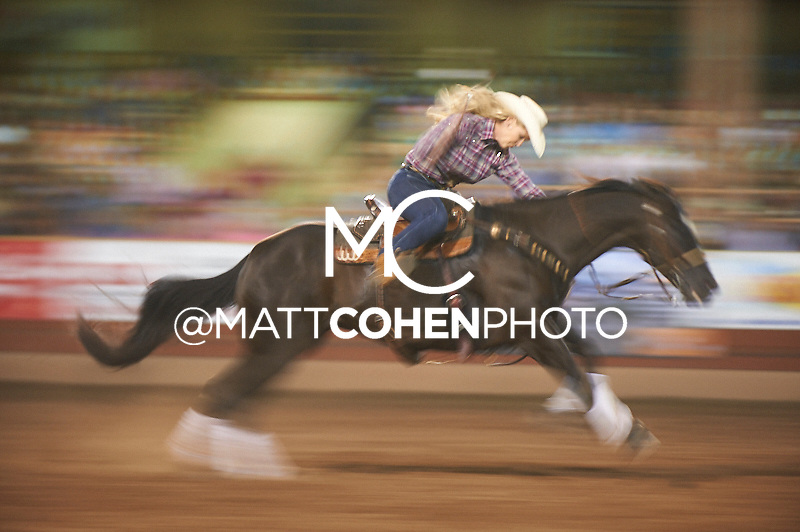 Barrel racer Lainie Whitmire of Marletta, OK competes at the Pikes Peak or Bust Rodeo in Colorado Springs, CO.<br /> <br /> <br /> UNEDITED LOW-RES PREVIEW<br /> <br /> <br /> File shown may be an unedited low resolution version used as a proof only. All prints are 100% guaranteed for quality. Sizes 8x10+ come with a version for personal social media. I am currently not selling downloads for commercial/brand use.