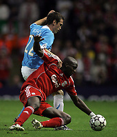 Photo: Paul Thomas.<br /> Liverpool v PSV Eindhoven. UEFA Champions League. Quarter Final, 2nd Leg. 11/04/2007.<br /> <br /> Csaba Feher (22) of PSV tackles Momo Sissoko.