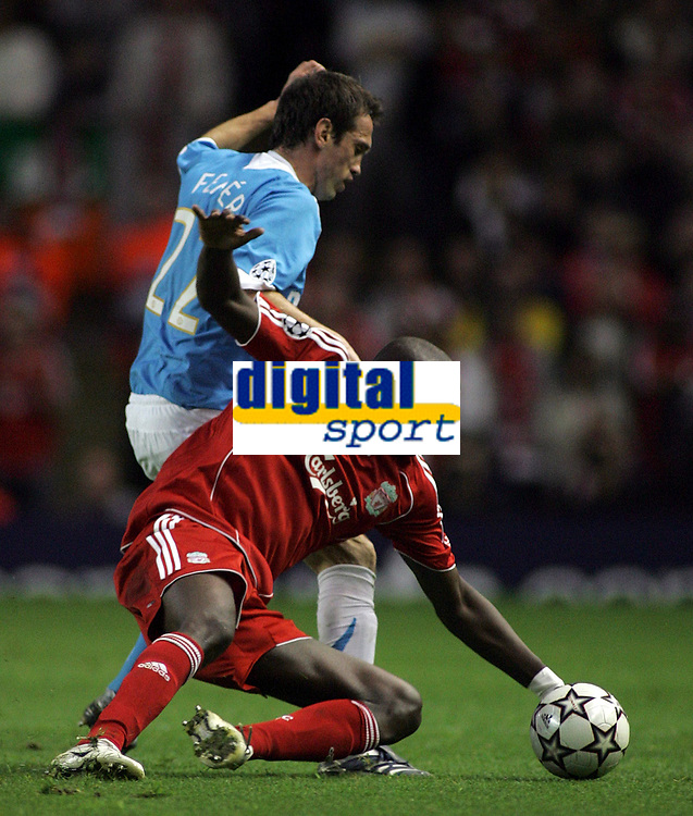 Photo: Paul Thomas.<br /> Liverpool v PSV Eindhoven. UEFA Champions League. Quarter Final, 2nd Leg. 11/04/2007.<br /> <br /> Csaba Feher (22) of PSV tackles Momo Sissoko.