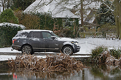 © Licensed to London News Pictures 08/02/2021.        Otford, UK.  A 4x4 driving round Otford's duck pond roundabout in Kent. The Met Office has warned of more freezing cold snowy weather to come with yellow and amber alerts in place for London, Kent and the South East. Photo credit:Grant Falvey/LNP