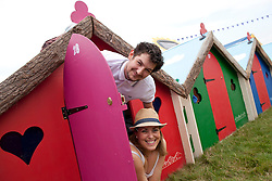 """© Licensed to London News Pictures . 24/08/2012 . Leeds , UK . James Wiley and Jo Green from Stockton-on-Tees , camp in high-end """" Podpads """" instead of traditional tents , at the Leeds Festival in Bramham Park . Photo credit : Joel Goodman/LNP"""