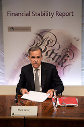 Governor of the Bank of England Mark Carney hosts a press conference to present the Bank's Financial Stability Report at its headquarters in central London.