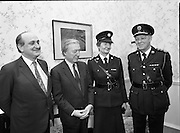 First Female Garda Superintendent.   (R97)..1989..21.02.1989..02.21.1989..21st February 1989..Ms Phyllis Nolan the first female Garda to reach the rank of Superintendent paid a courtesy call to An Taoiseach, Charles Haughey TD, at his office today. She was accompanied by the Garda Commissioner, Mr Eugene Crowley...Image shows (L-R) Mr Gerry Collins TD, Minister for Justice, An Taoiseach Mr Charles Haughey TD, Garda Supt, Phyllis Nolan and Garda Commissioner , Eugene Crowley at the office of An Taoiseach in Government Buildings.