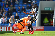 Chesterfield goalkeeper Aaron Ramsdale (1) saves the ball with Notts County forward Shola Ameobi (9) looking to score during the EFL Sky Bet League 2 match between Chesterfield and Notts County at the b2net stadium, Chesterfield, England on 25 March 2018. Picture by Jon Hobley.