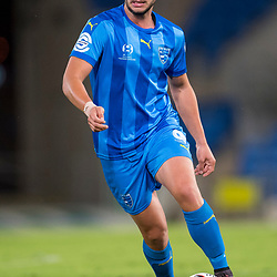 BRISBANE, AUSTRALIA - SEPTEMBER 20: Jacob Boutoubia of Gold Coast City dribbles the ball during the Westfield FFA Cup Quarter Final match between Gold Coast City and South Melbourne on September 20, 2017 in Brisbane, Australia. (Photo by Gold Coast City FC / Patrick Kearney)