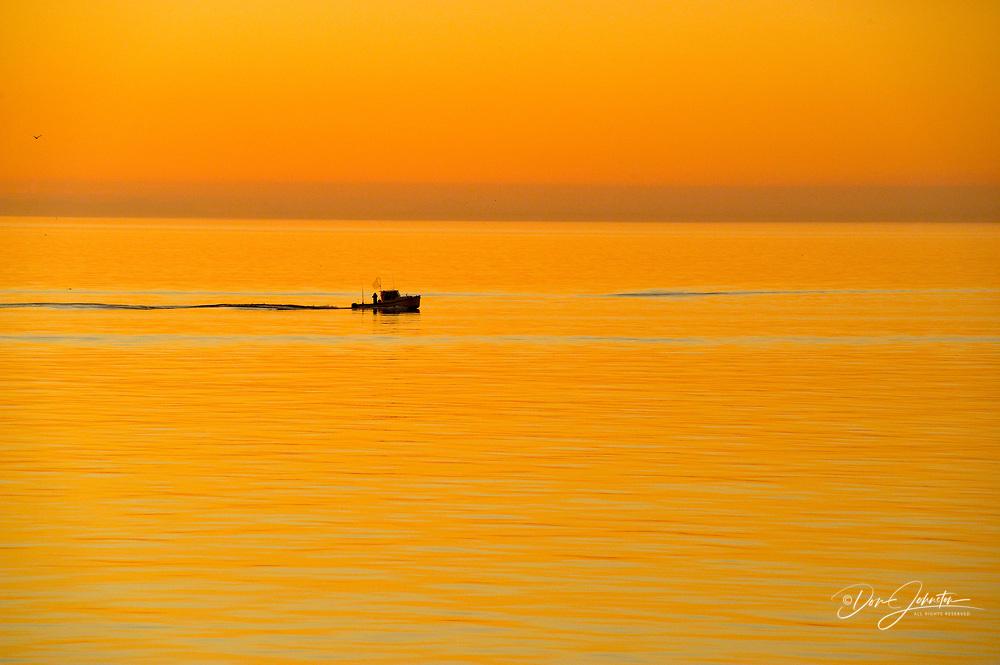 Sunrise over the Strait of Juan de Fuca with fising boat, Victoria, BC, Canada
