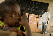 A teacher gives a lesson on basic English vocabulary during class at the Kotonli kindergarten in the village of Kotonli, northern Ghana, on Thursday June 7, 2007...