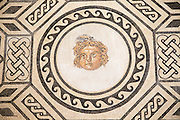 Roman mosaic of Medusa archaeological display inside the Alcazar palace, Cordoba, Spain