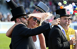 A crowd of racegoers take a selfie during day three of Royal Ascot at Ascot Racecourse. PRESS ASSOCIATION Photo. Picture date: Thursday June 21, 2018. See PA story RACING Ascot. Photo credit should read: Nigel French/PA Wire. RESTRICTIONS: Use subject to restrictions. Editorial use only, no commercial or promotional use. No private sales.