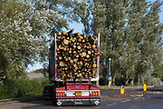 A truck carrying tree trunks leaves the Kent Renewable Energy Biomass CHP site in Discovery Park on 4th October 2021 in Sandwich, United Kingdom. The biomass-powered combined-heat-and-power CHP plant was opened in October 2018 and is said to be predominantly fuelled from wood supplied by EuroForest from local traditionally-managed coppiced woodlands.