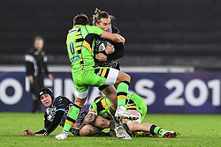 Ospreys' Jeff Hassler is tackled by Northampton Saints' Piers Francis<br /> <br /> Photographer Craig Thomas/Replay Images<br /> <br /> EPCR Champions Cup Round 4 - Ospreys v Northampton Saints - Sunday 17th December 2017 - Parc y Scarlets - Llanelli<br /> <br /> World Copyright © 2017 Replay Images. All rights reserved. info@replayimages.co.uk - www.replayimages.co.uk